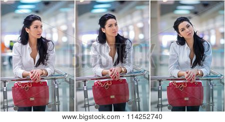 Attractive young woman with red bag in shopping center. Beautiful fashionable young lady