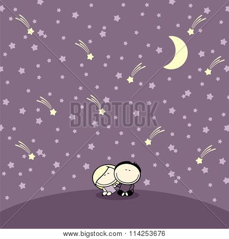 Couple sitting under night starry sky