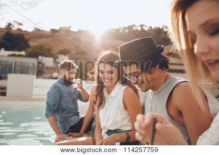 Handsome Man Partying With Friends At Poolside