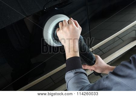 Car Service. Worker Polishing Of The Car