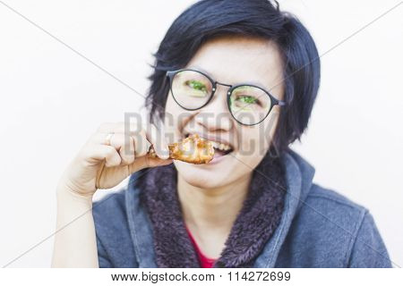 Asian Woman Eating Delicious Chicken