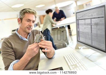 Engineer working in design office on desktop computer