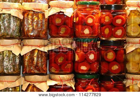 Italian Market  With Pots Of Peppers And Anchovies In Olive Oil