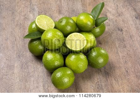 Fresh Citrus Lime With Mint Close Up On Wooden Background
