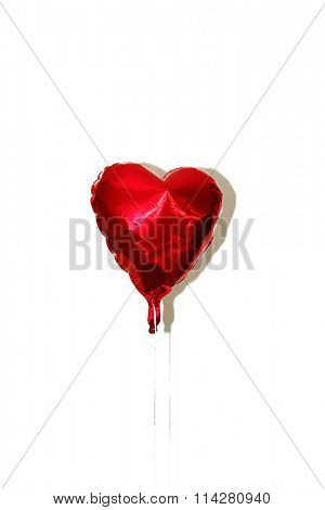 Valentines Day Red Heart Shaped Mylar Helium Balloons with White String and shadows. Isolated on white with room for your text.a