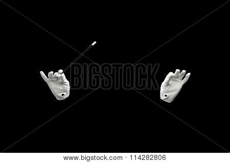 magician hands with magic wand showing trick