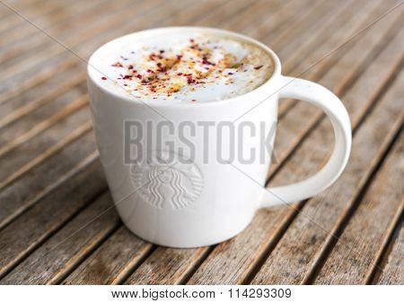 Khonkaen Province, Thailand - December 20, 2015 : Glass of Starbuck Coffee Blended Beverages served at wood table in starbuck shop at Khonkaen , Thailand.