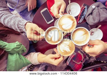 Group Of Friends Drinking Cappuccino At Coffee Bar Restaurant - People Hands Cheering And Toasting