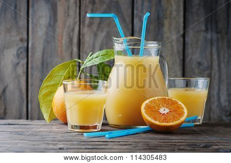 Healthy Fresh Orange Juice On The Woodent Table