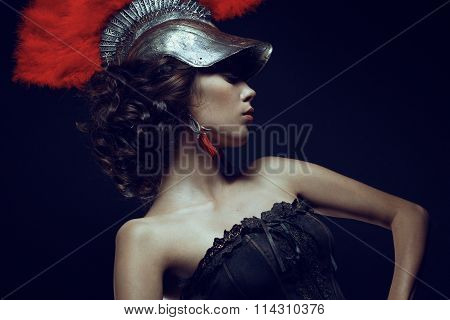 Woman in helmet with red feathers