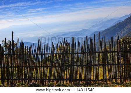 Bamboo Fence In Rural Field With Beautiful Natural Mountain Land Scape Wide Angle View Point