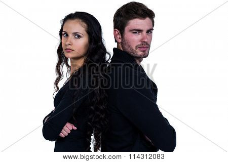 Couple back to back not talking after an argument on white screen