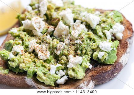 Avocado on toast with feta cheese, lemon and spices.