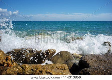 Sea Waves Hit Stony Seashore