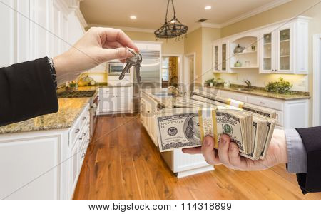 Handing Over Keys for Cash In Beautiful Custom Kitchen Interior.