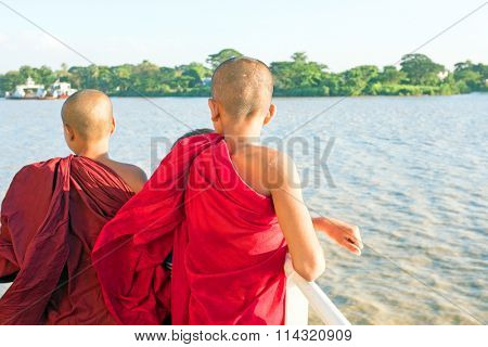YANGON, MYANMAR - november 24, 2015: Young monks on the ferry at Yangon, Myanmar. Buddhism in Myanmar is predominantly of the Theravada tradition, practised by 89% of the country's population.