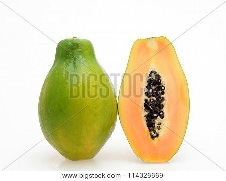 Fresh and tasty papaya half and whole fruit isolated white
