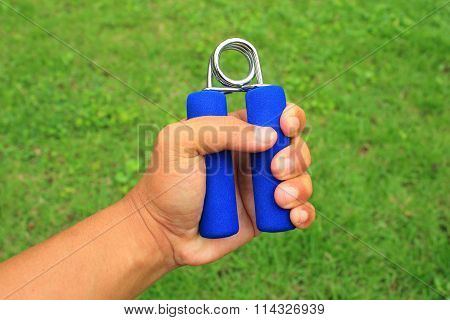 Hand Grip Strengthener On The Left Hand.