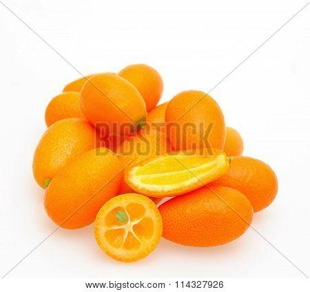 Kumquat fruit cross-section and whole