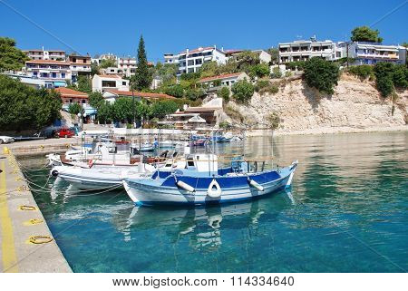 ALONISSOS, GREECE - SEPTEMBER 23, 2012: Small boats moored in the harbour at Votsi on the Greek island of Alonissos. The village lies just to the North West of Patitiri, Capital of the island.