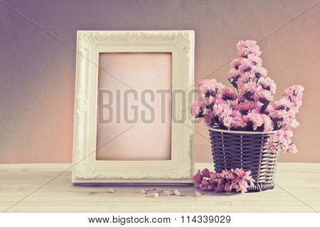 White Vintage Photo Frame With Sweet Statice Flower In Basket With Blank Wooden Label On Red Pink Ba