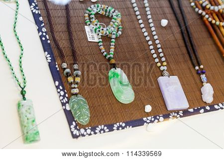 Chinese Amulets Made Of Green And Blue Jade