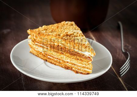 Piece of cake on white plate