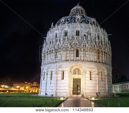 Baptistry Of St John Near The Leaning Tower Of Pisa Against A Dark Night Sky