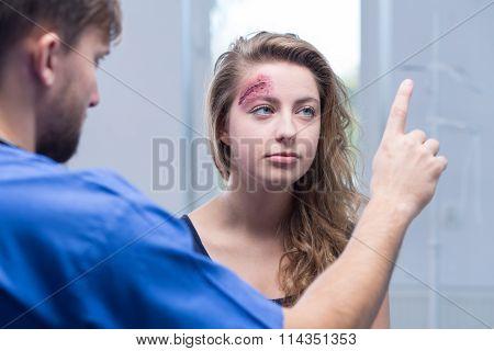Doctor Diagnosing Injured Woman