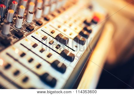 Close-up of music mixer button setting volume. Music production mixer adjustment tools poster