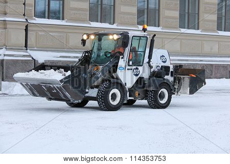 Snow Removal Tractor In City