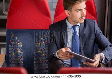 Businessman Using Public Transport