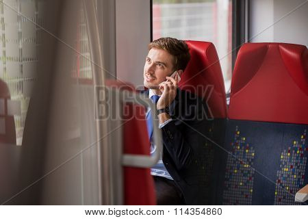 Passenger On Train With Cellphone
