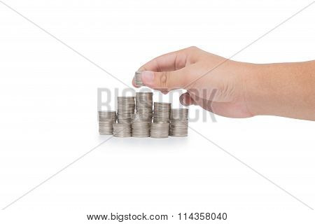 Hand Put Coins To Stack Of Coins Isolated On White