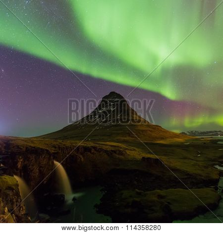 Beautiful Northern lights over Kirkjufell mountain