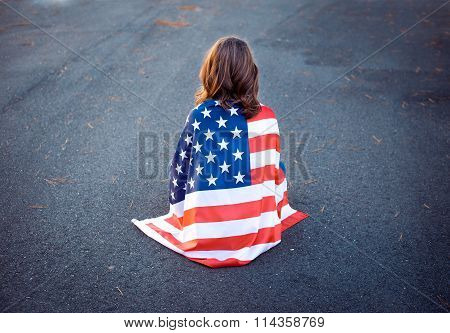 Sad Lonely Patriot Woman Sitting Down With The American Flag Wrapped Around Her. Deployment, Militar