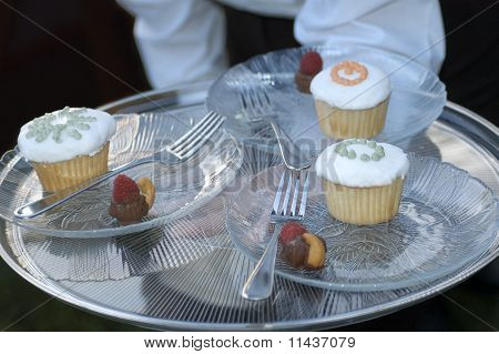 Tray of Desserts held by a Server
