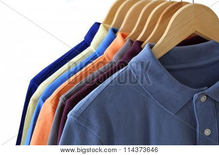Front view of polo shirts on hanger isolated over white background
