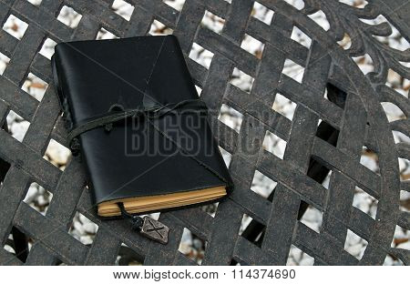 Closed Leather Bound Journal On Table Outdoors