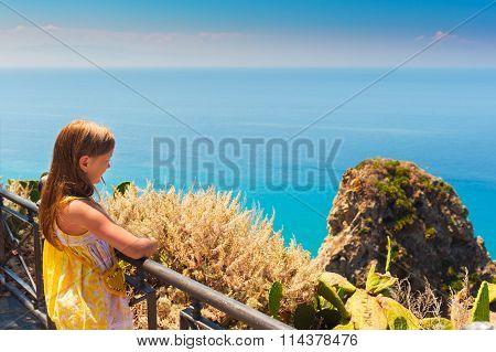 Adorable little girl admiring amazing view of Capo Vaticano