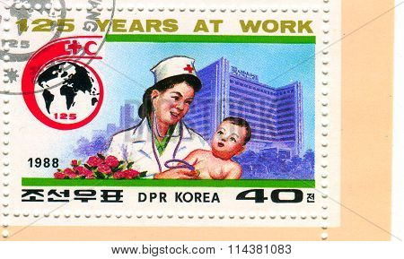 GOMEL,BELARUS - JANUARY 2016: A stamp printed in North Korea shows image of the 125 years at work of the Red Cross, circa 1988.