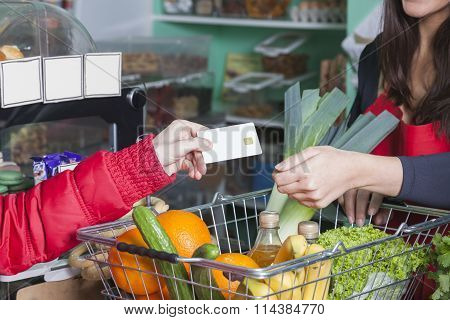 Customer Pays With Credit Card In Grocery