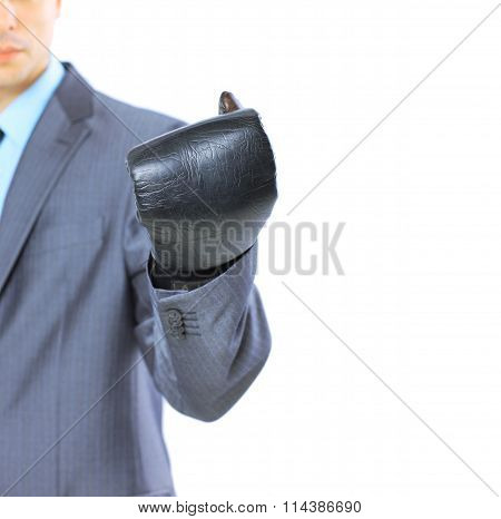 The young businessman in boxing gloves