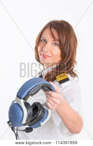 Beautiful woman pilot with headset used in aircraft poster