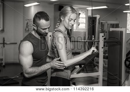 Sport couple on training in the gym. Healthy life