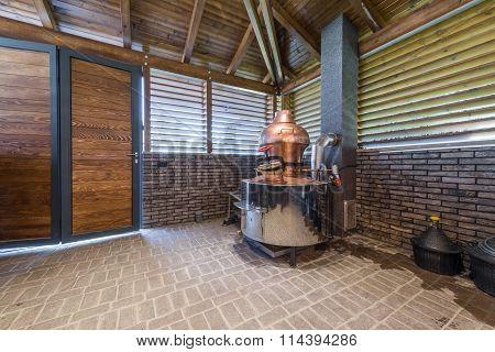 Cauldron for brandy in modern log cabin interior
