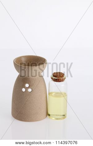 aroma theraphy oil with burner on the white background