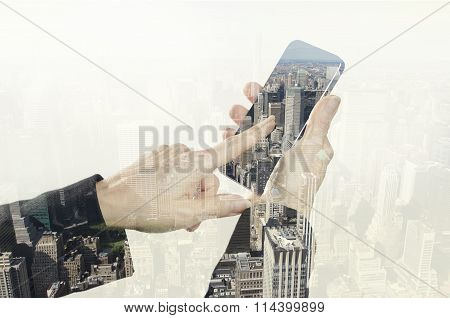 Hand holding smart phone and New York city.