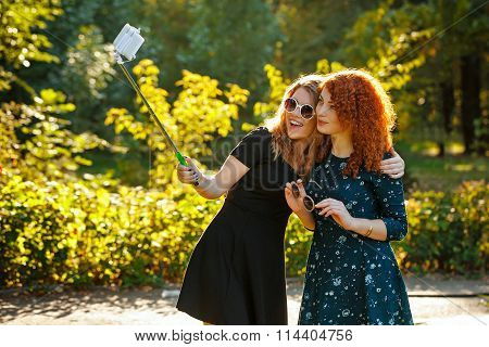 Two Girls Make Selfie.
