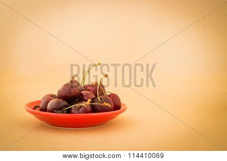Group Of Cherries On Warm Vintage Background